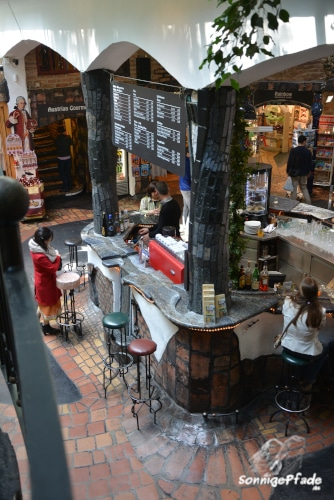 Bar in the Hundertwasser Village interior with tiles and columns